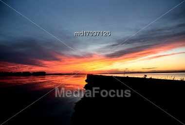 Prairie Sunset Lake And Road In Canada Stock Photo