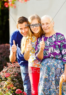 Precious Loving Family Members Showing Thumbs Up Stock Photo