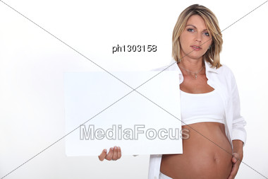 Pregnant Woman With White Poster Stock Photo