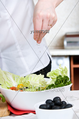 Preparation Of Vegetarian Salad From Fresh Vegetables Stock Photo