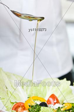 Preparation Of Vegetarian Salad From Fresh Vegetables Stock Photo