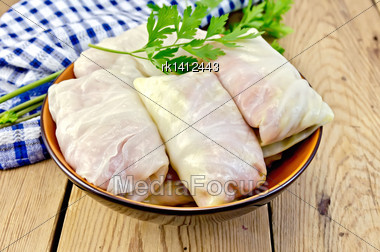 Prepared Stuffed Cabbage With Minced, Parsley In A Dish, Napkin On The Background Of Wooden Boards Stock Photo