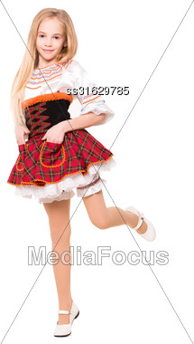Pretty Blond Girl In A Checkered Dress Posing On One Leg. Isolated Stock Photo