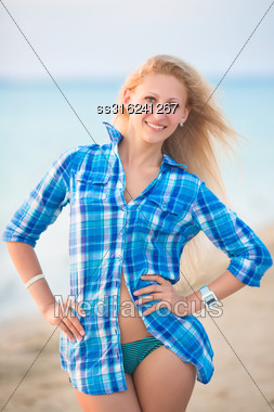 Pretty Blond Woman In Blue Blouse Posing On The Beach Stock Photo
