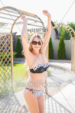 Pretty Blond Woman In Swimsuit Posing Outdoors Stock Photo