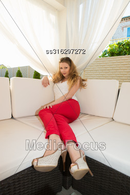 Pretty Blond Woman Wearing Red Panties Relaxing In Summer House Stock Photo