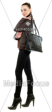 Pretty Brunette With A Bag Wearing Black Pants And Shoes. Isolated On White Stock Photo