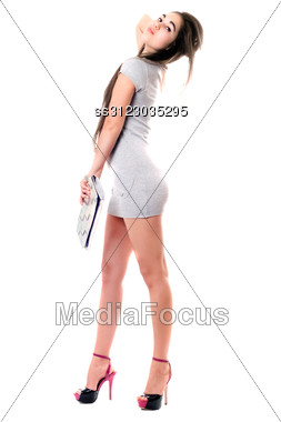 Pretty Brunette In Gray Dress. Stock Photo