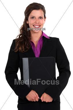 Pretty Businesswoman All Smiles Holding Laptop Stock Photo