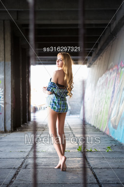 Pretty Leggy Blond Woman Posing In Shirt Outdoors Stock Photo