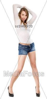 Pretty Leggy Blond Woman Wearing Blue Jeans Shorts, White Blouse And Black Shoes. Isolated Stock Photo