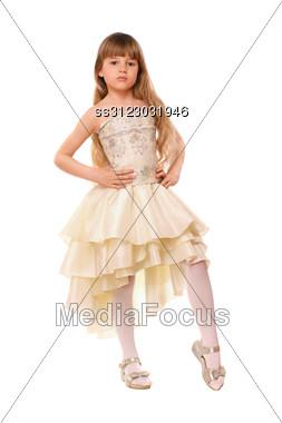 Pretty Little Girl In A Beige Dress. Stock Photo