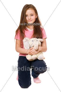Pretty Little Girl With A Teddy Elephant. Stock Photo