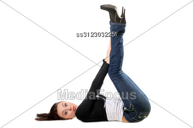 Pretty Playful Brunette Lies On Her Back Stock Photo