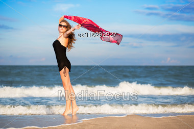 Pretty Slim Woman With Pink Pareo Posing On The Beach Stock Photo