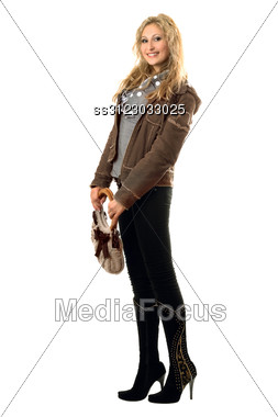 Pretty Smiling Young Blonde With A Handbag. Stock Photo
