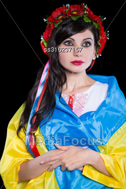 Pretty Ukrainian Brunette Posing In Poppy Wreath. Isolated On Black Stock Photo