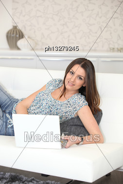 Pretty Woman Using Credit Card To Buy Online Stock Photo