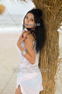 Pretty Young Brunette On A Beach Near The Palm Tree Stock Photo