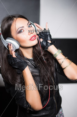 Pretty Young Brunette Listening To Music With Headphones Stock Photo