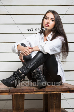 Pretty Young Brunette Posing In Fashionable Clothes Stock Photo