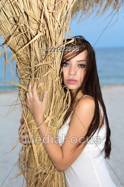 Pretty Young Brunette Posing Near The Sea Stock Photo