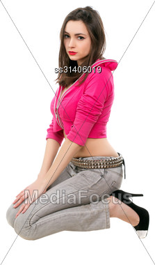 Pretty Young Brunette In Short Jacket Sitting On Her Knees. Isolated On White Stock Photo