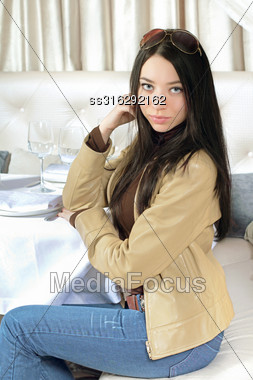 Pretty Young Brunette Sitting At Table In A Cafe. Isolated On White Stock Photo