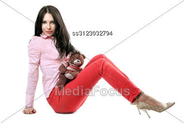 Pretty Young Brunette With A Teddy Bear Stock Photo