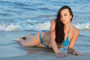 Pretty Young Caucasian Lady Posing On The Beach Stock Photo