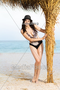 Pretty Young Caucasian Woman In Grey Hat Posing Near The Palm Stock Photo