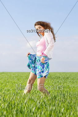 Pretty Young Woman In A Green Field Stock Photo