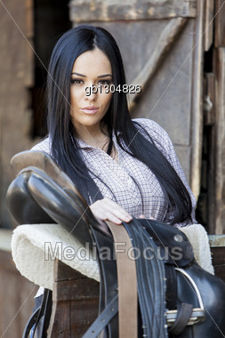 Pretty young woman in the stable Stock Photo
