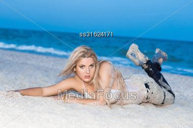 Pretty Young Woman Posing Near The Sea Stock Photo