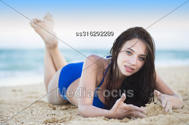 Pretty Young Woman Posing Near The Sea Stock Photo