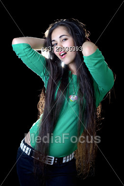 Pretty Young Woman Unbinding Her Long Hair. Stock Photo