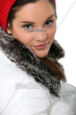 Pretty Young Woman Wearing Coat With Fur Stock Photo