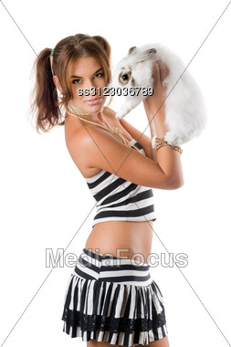 Pretty Young Woman With Little Rabbit. Stock Photo