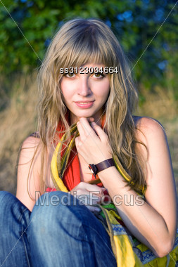 Pretty Young Woman With Yellow Bag Outdoors Stock Photo