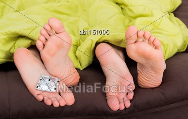 Preventing Unwanted Pregnancy And Sexual Diseases With Condom Stock Photo