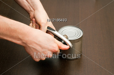 Process Of Opening The Metal Can With Preserved Foods Stock Photo