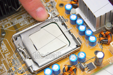 Processor On The Yellow Computer Motherboard Stock Photo