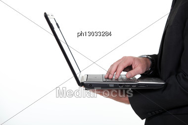 Profile Of A Businessman With A Laptop Stock Photo