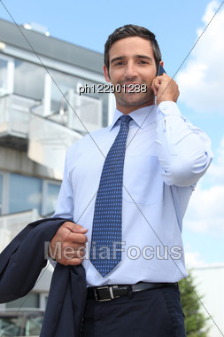 Promoter Taking A Call Stock Photo