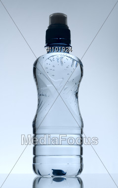 Purified Mineral Water On The Wet Glass Desk With Reflection Stock Photo