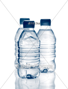 Purified Spring Mineral Water In The Bottles With Reflection Stock Photo