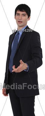 Puzzled Businessman Stock Photo