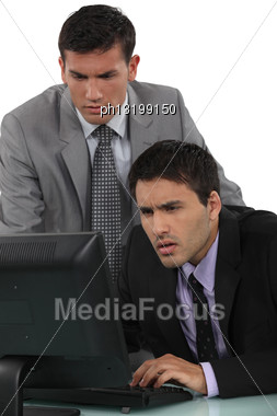 Puzzled Businessmen With A Laptop Stock Photo