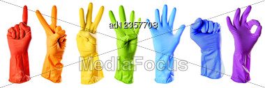 Raibow Color Rubber Gloves On White Stock Photo