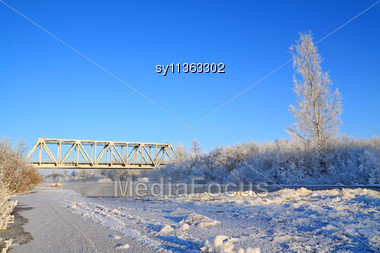 Railway Bridge On Freeze River Stock Photo